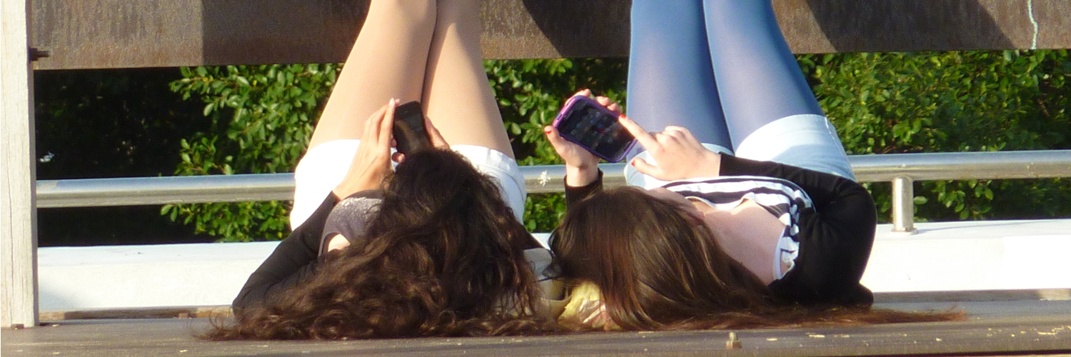 Women on mobile phones