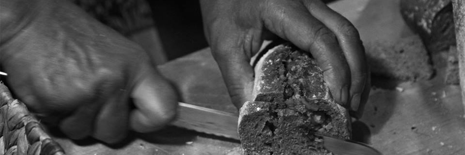 hands cutting bread